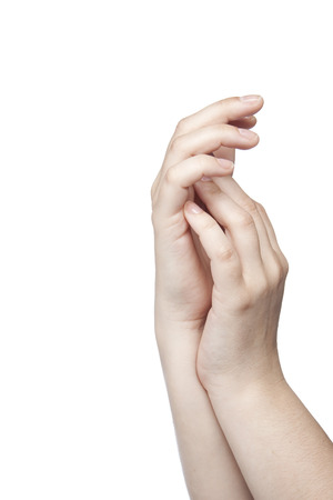 positiv: two hands touching one another, white background Stock Photo