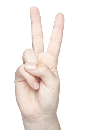 photo of a hand on a white background, a sign of peace