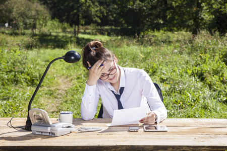 careerist: business woman grabs your head, reading a new contract