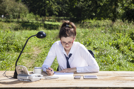 careerist: business woman takes to sign agreement Stock Photo