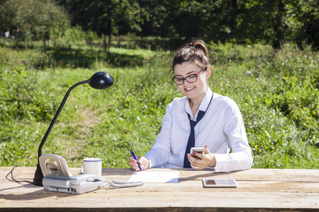 careerist: business woman sitting in the office which is on the outside