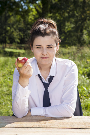careerist: Portrait of business woman eating an apple Stock Photo