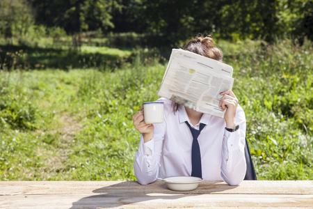 careerist: business woman hiding behind a newspaper