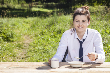 business woman eats breakfast in the open air Stock Photo