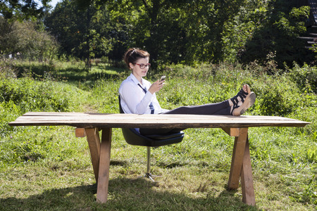 business woman working: business woman taking a rest from everyday life Stock Photo