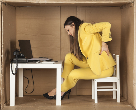 cramped space: back pain, cramped office and lack of space