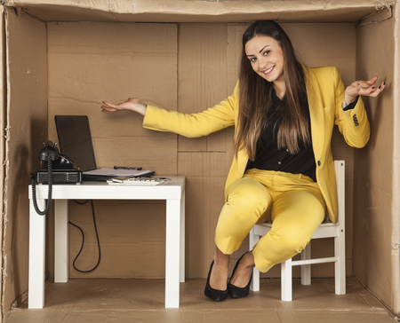 cramped: business woman is happy about the new small office