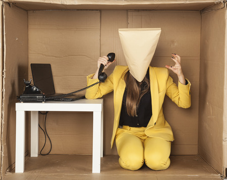 nervousness: upset business woman with her head covered