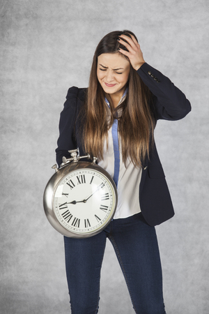 dissatisfaction: business woman has a headache from these delays