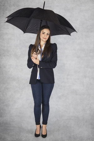 business woman under an umbrella, protection of worker