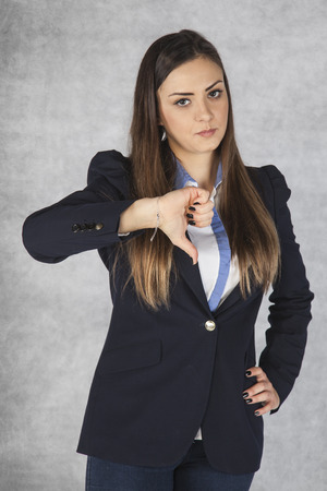 business woman shows thumb down