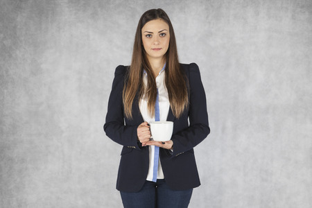 politeness: business woman holding a cup of coffee Stock Photo