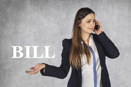 when: helplessness when receiving phone bill Stock Photo