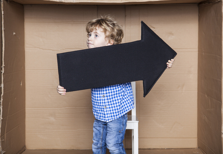 careerist: young businessman holding an arrow in his hands