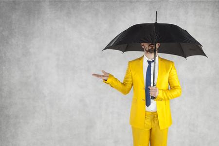 insurance agent under the umbrella, next to the copy space Foto de archivo