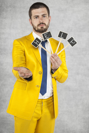 servitude: businessman begs and asks for help Stock Photo