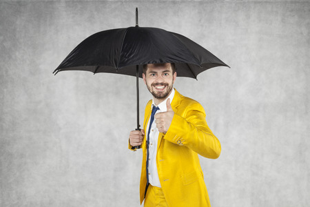 formalities: insurance agent under the umbrella Stock Photo