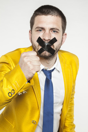 politician sealed his mouth calls for rebellion Stock Photo