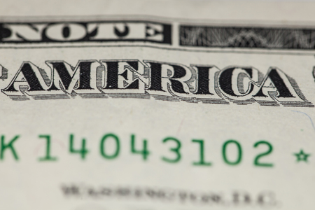 determinant: Closeup on the inscription of america, on a one dollar bill Stock Photo