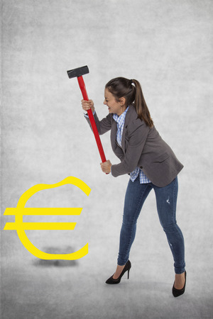 arrears: Business woman destroying the euro symbol Stock Photo