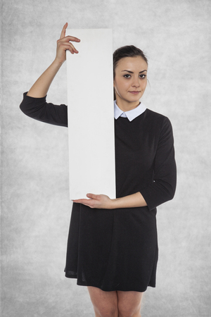 principles: Beautiful woman holding a blank billboard, space for AD