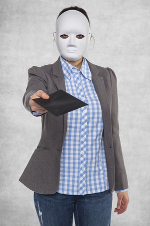 enforce: Business woman in a mask, gives a bribe