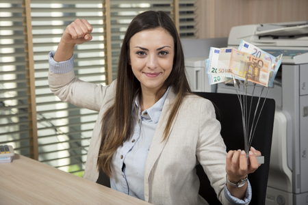 Business breakthrough, businesswoman holding a prize Stock Photo