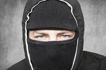 Close-up on man in balaclava, suspicious type