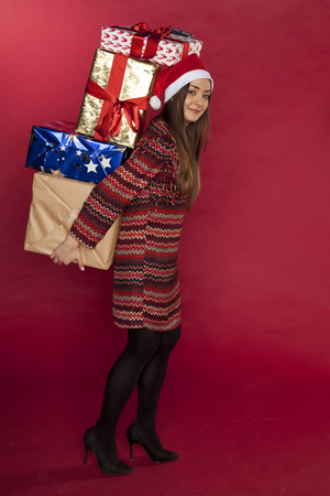 beautiful girl carries a lot of gifts, Stock Photo