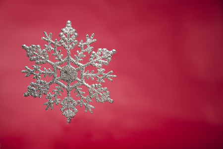 snowflake on red backgroundSnowflake on wood