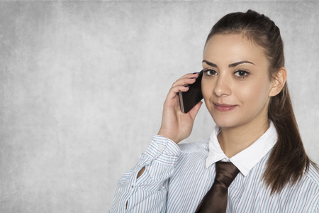 businesswoman is negotiating on a mobile phone Stock Photo