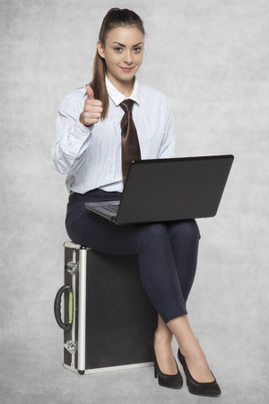 thumbs up for work on the move Stock Photo