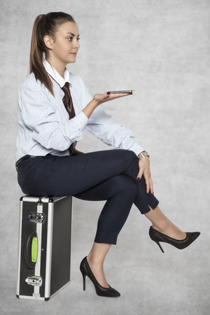 beautiful businesswoman uses a mobile phone