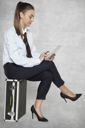 businesswoman makes the time of waiting, more pleasant with new technologies