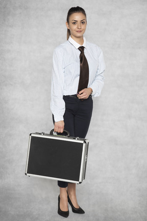 Young and beautiful businesswoman in elegant work clothes Stock Photo
