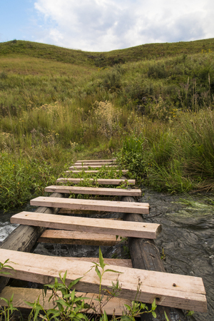 old wooden walkway through the river, Drakensberg, South Africa