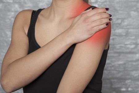 an injured shoulder, hurts a woman