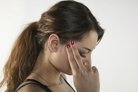 A young woman is struggling with pain, isolated on background 版權商用圖片