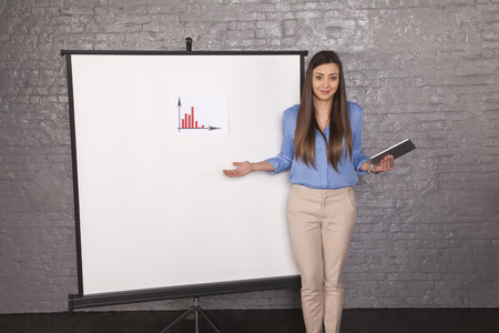 helpless business woman trying to explain a graph