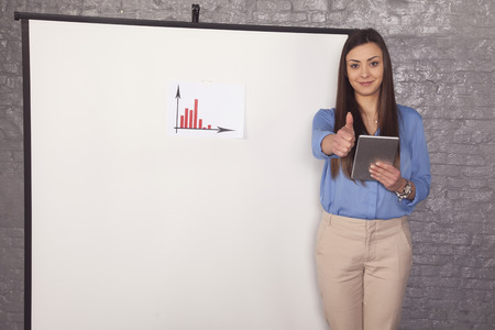business woman shows thumbs up, increase chart Фото со стока
