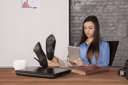 focused business woman uses a tablet