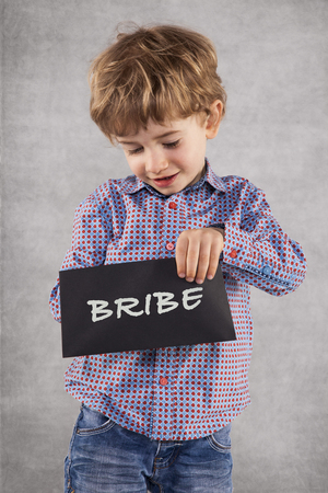 little businessman with a envelope, concept of bribing