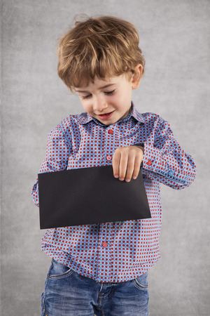 young businessman peeks into an envelope with a bribe