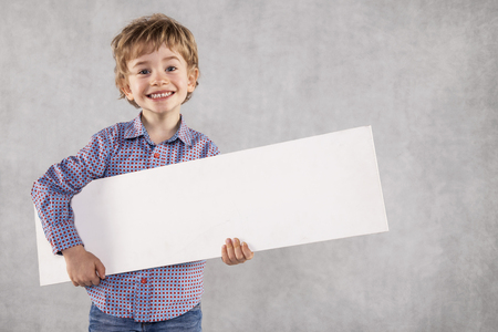 young businessman holding an advertising space in his hands, white copy space