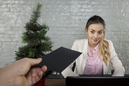 business woman is rewarded for work during Christmas Foto de archivo