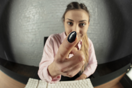 business woman is working on the computer, threatens with finger
