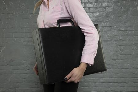 secretary holds a briefcase under his arm Banco de Imagens