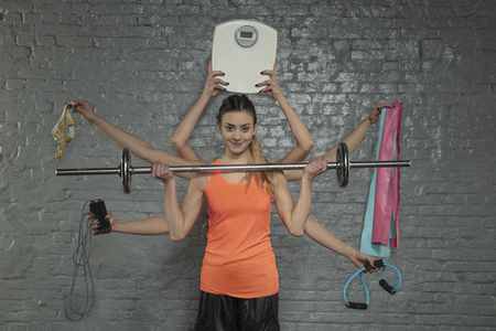 young athletic woman doing several exercises at a time