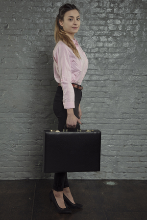 proud business woman ready to work, briefcase in hand