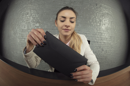 business woman received a black envelope as a gift, the concept of a bribe